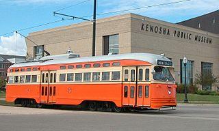 320px-kenosha_streetcar_4615_in_2005_passing_kenosha_public_museum