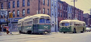 320px-phila-_1968_-_pcc_trolley_on_route_50_meeting_a_brill_trolley_bus2c_7th_26_snyder